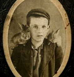 Antique Victorian CDV photo of a handsome little boy with two baby bunnies perched on his shoulders.