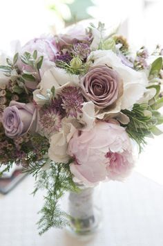 These muted tones would be pretty against plum -- very romantic -- Flowers are a white hydrangea base, light pink peonies, Lavender Roses, Purple Astrantia