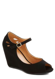 This matte black peep toe features teardrop cutouts that look notable against a pair of bright tights. Description from shop.eonew.com. I searched for this on bing.com/images