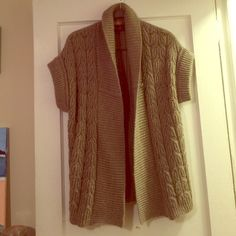 Berretti 100% wool cable knit sweater. Size S. Beautiful chunky knit cable sweater (open) in a nice camel tone. 100% wool perfect for over layering. Size small with stretch (fits any medium probably) Berretti brand (expensive Italian sweater brand) worn one time! Literally new super cute excellent deal! PRICE JUST LOWERED WEEKEND SPECIALS!!!!! Berretti Sweaters
