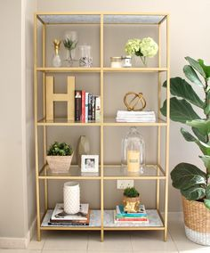 DIY: Gold ikea bookshelf - something like this but horizontal would be lovely in. - Ikea DIY - The best IKEA hacks all in one place Gold Bookshelf, Gold Shelves, Bookshelves, Glass Shelves, Bookshelf Ideas, Ikea Bookshelf Hack, Ikea Shelf Hack, Wallpaper Bookshelf, Ikea Shelving Unit
