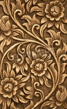 Pattern of flower carved on wood background via MuralsYourWay.com