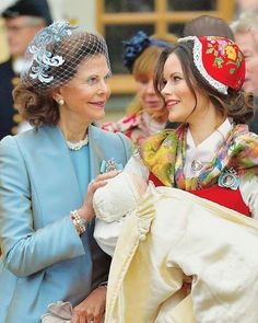 (L) Queen Silvia of Sweden were the picture of proud grandmother as she witnessed her youngest grandchild's Prince Gabriel christening as he lay in Princess Sofia's arms after the ceremony at the Drottingholm Palace Chapel on December 1, 2017 in Sweden.