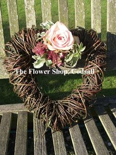 Rustic wicker heart with a single rose and mixed floral cluster. Can be placed on the church door or in the entrance. Wicker Dresser, Wicker Couch, Wicker Trunk, Wicker Mirror, Wicker Headboard, Wicker Shelf, Wicker Bedroom, Wicker Table, Wicker Furniture