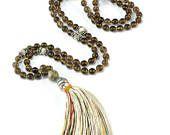 Stylish and sophisticated mala necklace. 108 semi precious stones of smoked quartz surrounded by lem