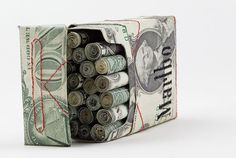 'Theme' of abstract, mechanically invented and projected ILLUSIONS: 'money' 'cigarettes'