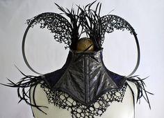 Black feather, Steel Boned, 'Lizard Skin', Neck Corset with Blue/Black fabric. $230.00, via Etsy.