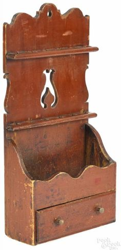 Description: Painted pine hanging spoon rack, ca. retaining an old red surface, 27 h., 13 w.