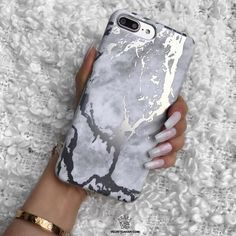 Protective White Marble print marble phone case layered with a shiny Silver Chrome pattern completed in a matte finish. Available on Velvet Caviar!