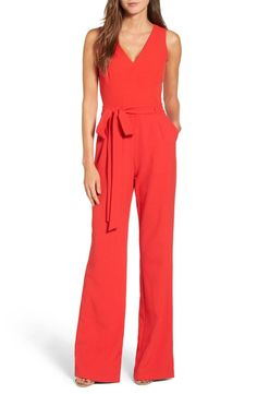 Crisp crepe gives flattering flow to this wide-leg jumpsuit tailored with darts and a tied waist for a flattering fit.