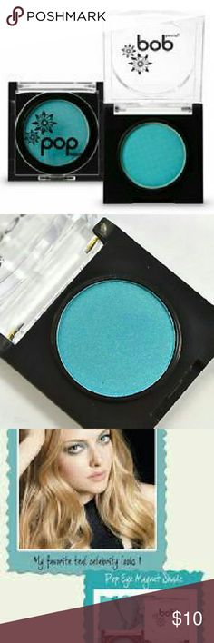 Pop Beauty Eye Magnet Eyeshadow Tantalizing Teal Pop on this powder glaze to magnetize your gaze! This mineral-enriched, silky eyeshadow easily creates a multitude of eye glimmering effects.  ~ Super silky pigments ~ Oil absorbing ~ Mineral enriched ~ Crease resistant Pop Beauty Makeup Eyeshadow
