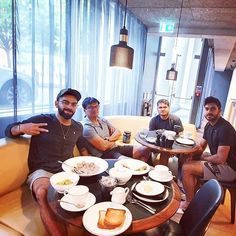 Virat Kohli with Vijay Shankar and Indian team staff members at the breakfast table Virat Kohli Wallpapers, Best Couple, Cricket News, Rocks, Cap, Indian, Breakfast, Table, Baseball Hat