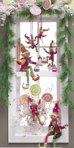 christmas elves adorning a window