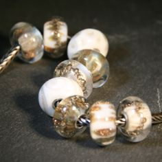 White and gold by Anne Meiborg. fit Trollbeads. www.annemeiborg.etsy.com