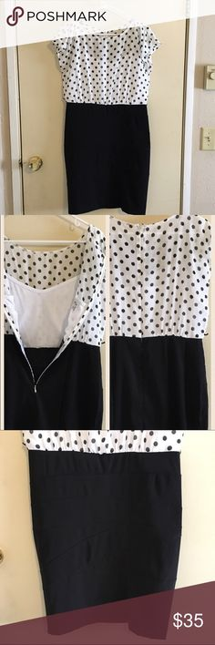 Alyx Limited black/white blocked polka for dress Alyx Limited colorblock dress.  Skirt portion is completely black with subtle pattern (see photo 3) while the top is a sheer white chiffon with black polka dots. Attached white cami and hidden back zipper. Has two thin belt loops but belt is not included. Reasonable offers welcome. Size 10. Alyx Limited Dresses