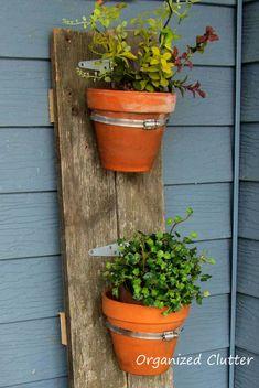 Reclaimed Wood Terra Cotta Pot Holder Tutorial www.organizedclutterqueen.blogspot.com