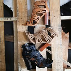 """Add pizazz to your ensemble with the Cut Out Ankle Booties! Features an open toe, cut out pattern, faux leather upper, and back zipper. Finished with a slightly padded insole and a chunky faux wooden 4"""" heel. Pair with jeans or a matching set for a hot summer look!"""