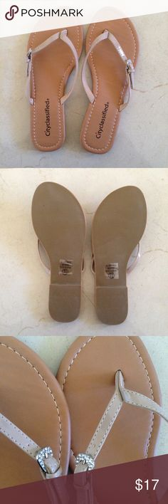 NWT 7.5 Nude Buckle Rhinestone Flip Flops Sandals NWT 🔸 Women's size 7.5 Nude Rhinestone Embellished Buckle Flip Flops Sandals by City Classified 🔸 Never Worn! Perfect Condition! Stickers still attached on bottom sole! 🔸 Can come with box, which has some minor damage to it: hole on cover and dented in on one side *as shown in picture* 🔸 Comes from 💯% smoke free home 🚭 Feel free to ask my any questions! ☺️ Shoes Sandals