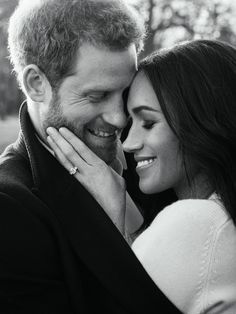 One of the photos is an intimate black-and-white portrait of the couple embracing, while the other is a more formal picture of the two sitting together holding hands. Both show off Markle's engagement ring.