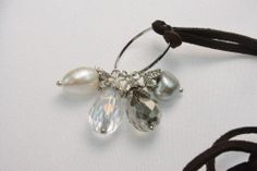 AYNRX3245:           Elegant 8/14mm pearls and smoke crystal pendants with 35.4 inches leather cord.             : This item is handmade each pearl and crystal are unique.       Symbolism:              Grey pearl represent protection, balance and allure.          Symbolism:              Smoke Crystal represent power, Energy and Clarity.                                     $10.00