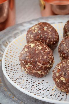 These Raw & Guilt-Free Peanut Butter Brownie Bliss Balls are the perfect healthy treat... even though they taste super naughty! Includes a simple step by step recipe video!