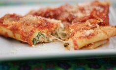 Spinach Manicotti Tomato Sauce Tomato Sauce  1 28-ounce can crushed tomatoes 2T extra-virgin olive oil 2 medium cloves garlic, minced ¼t red pepper flakes Table salt 2T chopped fresh basil Filling and Pasta  1½c part-skim ricotta cheese 1c grated Parmesan cheese 1c shredded mozzarella cheese 1 large egg, lightly beaten 5 oz frozen chopped spinach, thawed, squeezed dry, and chopped fine (1/2 of a frozen box of spinach) 1T. chopped fresh basil pinch ground nutmeg 10 -12 no-boil lasagna noodles