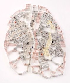 Matthew Picton makes sculptural maps of cities out of books about the respective city (here: Dublin in 1904, created from James Joyce's Ulysses):