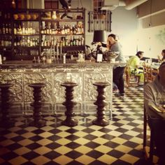 amazing pressed tin bar - love pressed tin ceiling treatments.. imagine this on a kitchen ceiling!