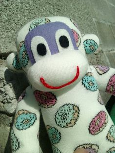 Check out this item in my Etsy shop https://www.etsy.com/uk/listing/249738363/sock-monkey-with-added-doughnuts