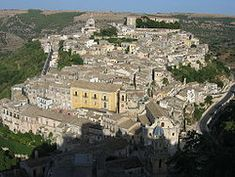 Ragusa (Italian: [raˈɡuːza], About this sound listen (help·info); Sicilian: Rausa; Latin: Ragusia) is a city and comune in southern Italy. It is the capital of the province of Ragusa, on the island of Sicily, with around 75,000 inhabitants. It is built on a wide limestone hill between two deep valleys, Cava San Leonardo and Cava Santa Domenica. Together with seven other cities in the Val di Noto, it is part of a UNESCO World Heritage Site. (Cat)