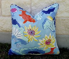 So pretty! This fun koi print pillow cover is done in your choice of size. It is done in a polyester outdoor fabric featuring colors of blues, white, orange,yellow, hot pink, aqua and gray. There is a spotted blue and white cording around the pillow. There is a zipper closure on the back and all inside edges are professionally finished. The insert is NOT included but there is a link for some below.  This would be such a great looking addition to any of your outdoor spaces. Be sure to check…