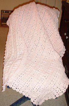 Cuddle Soft Baby Blanket  By: Nancy's Crochet           This free baby afghan pattern gives you the sweetest little cuddle soft baby blanket. Red Heart Baby is used to work up this blanket in rows while the border is worked in rounds. Front post double and back post double crochet stitches make this blanket.