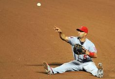 Don't get up -        Albert Pujols of the Los Angeles Angels throws to first base to put out David Lough of the Baltimore Orioles in the fifth inning May 16 in Baltimore. The Angels won 6-1.  - © Greg Fiume/Getty Images