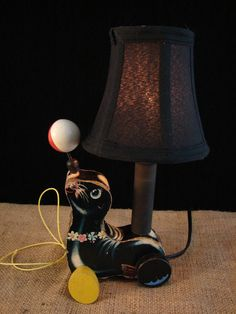 Upcycled Vintage Fisher Price Seal Pull Toy Lamp by BenclifDesigns, $73.00