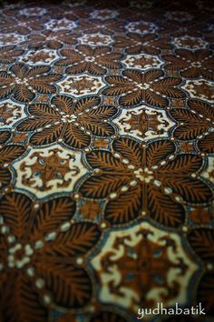 "Old stamped batik in ""ceplokan"" pattern. Ceplokan is one of some geometrical form of batik. The pattern is repetitive in so many different design. One of the most ceplokan pattern is ""kawung"" - Solo, Central Java"