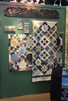 The Indonesian carved textile hanger from Gado Gado beautifully accents these handmade quilts.  Quilt Market - Fall 2012 by Timeless Treasures Fabrics, Inc., via Flickr