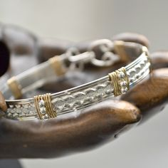 "Sterling silver wire wrap bracelet with 14K gold filled accents.  size 7  ""Serendipity"" by Untwistedsister on Etsy https://www.etsy.com/listing/185961268/sterling-silver-wire-wrap-bracelet-with"