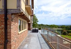 Stubblefield - Large patio leading out from the main hall and overlooking the fantastic views of the valley below. Oak Framed Buildings, Oak Frame House, Energy Efficient Homes, The Far Side, Traditional House, Modern Architecture, Exterior, Patio, Gallery