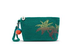 Have fun with colorful crochet, the Palm Spring Cosmetic in Azure Palm Tree Print.