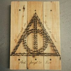 Homemade Harry Potter Wall Decor - wood, nails, string, wood burned, or marker.