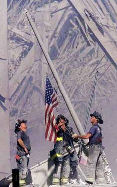 FDNY firefighters raise the flag over Ground Zero