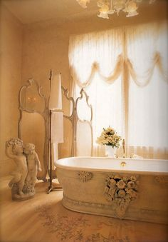 .Wow, this is like my dream bathroom with little cherubs. I think a canopy, very sheer with twinkle lights would look beautiful with it. oh, and a chandelier instead of that light fixture