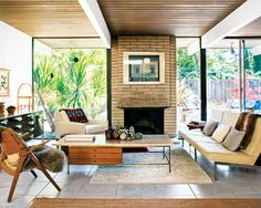 Mark Neely  Paul Kefalides Home | Architect: Claude Oakland for Joseph Eichler | San Rafael, CA | Photo: Drew Kelly -Travertine-Topped Coffee Table by Paul McCobb -Florence Knoll Parallel Bar System Sofa -Josef Albers print Over Fireplace -Hans Wegner Sawback Chair Via
