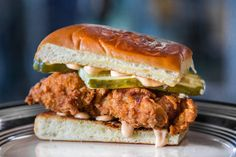 Make this fried chicken sandwich featuring sriracha mayo, dill pickle slices, Hawaiian sweet rolls, and the best chicken you've ever tried.