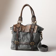 "PASSAGEWAY BAG -- A leather and denim bag with a well-traveled, timeworn appeal. Plenty of pockets inside and out with removable, adjustable strap. Each is unique. Leather/demin. Imported. Approx. 16""W x 5""D x 13""H."