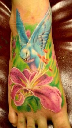 bird and lily by tattoo andy of mutiny