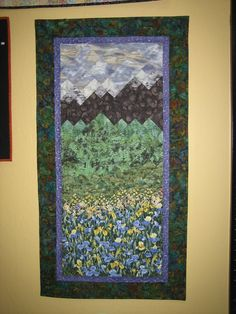 Wall Hanging Art Quilt With Purple Irises and Purple Sky Mountain