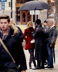 Emma and Hook filming <<< HA! More like Killian walking Emma home from a date back in Storybrook when it started to rain he whipped out this thing called an umbrella (that he's never used before) and tried to open it up. When he finally figured out how he had her laughing hysterically just before he leaned in and... *sighs* pretty sure y'all know where I was going with that!