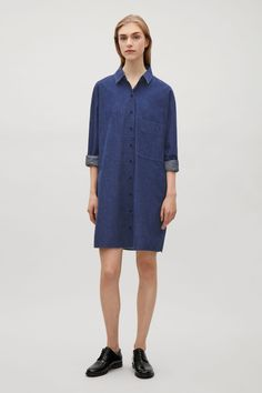Made from a soft cotton-denim, this shirt dress is an oversized style with a pointed collar. Loosely fitted, it has a large chest pocket, long cuffed sleeves and subtle slits at the sides.
