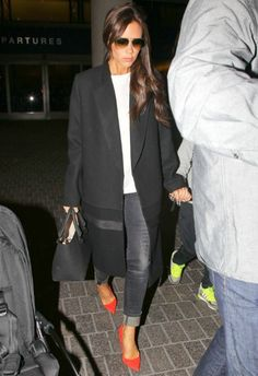 Victoria Beckham wearing Victoria Beckham Liberty Leather Tote Manolo Blahnik BB Pumps in Scarlet R13 Kate Skinny Jeans in Orion Black